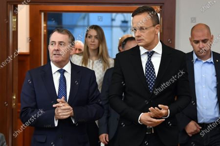 Hungarian Minister of Foreign Affairs and Trade Peter Szijjarto (2-R) and British Member of the Parliament and former Secretary of State for Defense and for International Trade Liam Fox (L) arrive at their joint press conference in Budapest, Hungary, 14 September 2020. Fox is the United Kingdom's candidate to be the next director-general of the World Trade Organization (WTO).