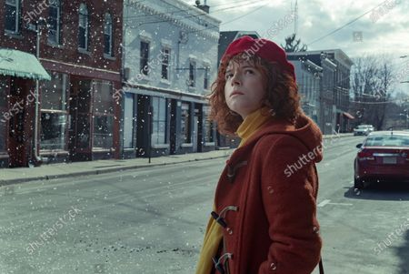 Jessie Buckley as Young Woman