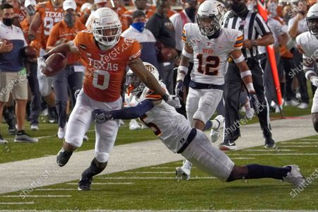 Texas' Tarik Black (0) runs through the tackle of UTEP's Dy'Vonne Inyang (5) during the first half of an NCAA college football game in Austin, Texas