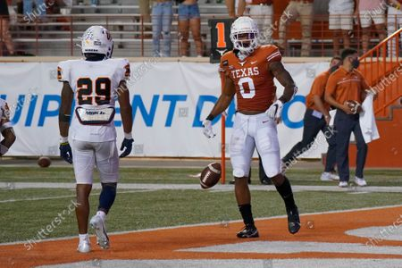 Texas' Tarik Black (0) reacts after a touchdown catch against UTEP's Duron Lowe (29) during the first half of an NCAA college football game in Austin, Texas