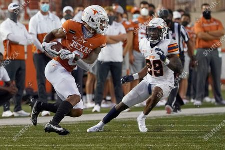 Texas' Tarik Black (0) runs after a catch as UTEP's Duron Lowe (29) defends during the first half of an NCAA college football game in Austin, Texas