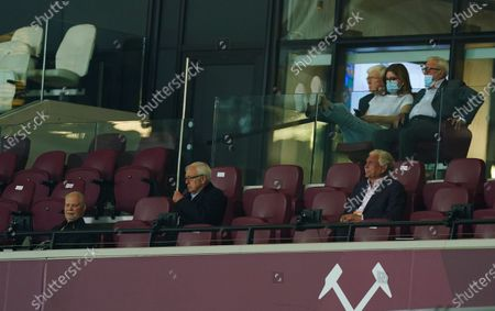 Joint Chairman of West Ham, David Gold sits at the front of the Director's box at the London Stadium, near former player Trevor Brooking, and Vice-Chairman Karen Brady (top)