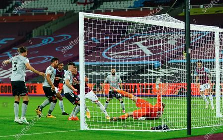 Charlton Athletic goalkeeper Ben Amos sits on the ball after a shot from Andriy Yarmolenko of West Ham
