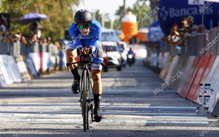 British rider Simon Yates of the Mitchelton-Scott team wearing the overall leader's blue jersey crosses the finish line of the 8th stage of the 55th Tirreno-Adriatico 2020 cycling race, an individual time trial over 10.1km, in San Benedetto del Tronto, Italy, 14 September 2020. Yates won the overall classification.