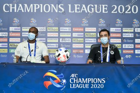Head coach Xavi Hernandez (R) and player Abdelkarim Hassan of Al Sadd attend a press conference ahead of the group D match of AFC Champions League between Al Sadd of Qatar and Al Ain of United Arab Emirates in Doha, capital of Qatar, Sept. 14, 2020.