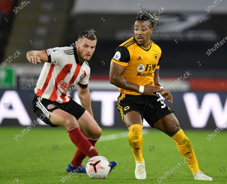 Wolverhampton's Adama Traore (R) in action against Sheffield's Jack O'Connell (L) during the English Premier League soccer match between Sheffield United and Wolverhampton Wanderers in Sheffield, Britain, 14 September 2020.
