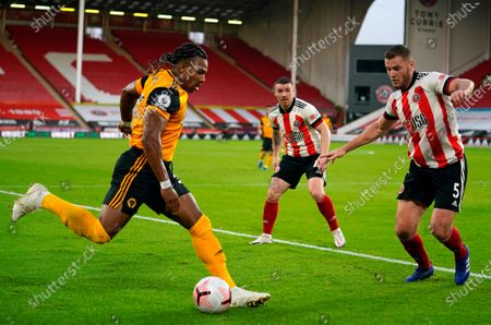 Wolverhampton's Adama Traore (L) in action against Sheffield's Jack O'Connell (R) during the English Premier League soccer match between Sheffield United and Wolverhampton Wanderers in Sheffield, Britain, 14 September 2020.