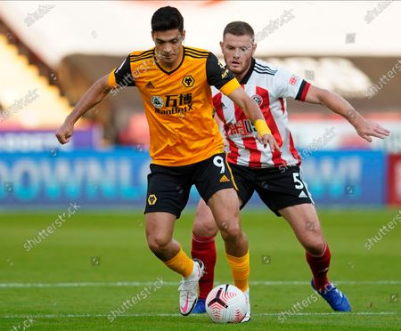 Wolverhampton's Raul Jimenez (L) in action against Sheffield's Jack O'Connell (R)  during the English Premier League soccer match between Sheffield United and Wolverhampton Wanderers in Sheffield, Britain, 14 September 2020.