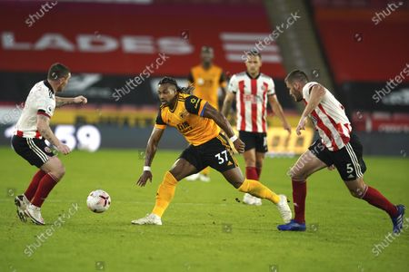 Stock Picture of Sheffield United's John Fleck, left, Wolverhampton Wanderers' Adama Traore, centre, and Sheffield United's Jack O'Connell, right, compete for the ball during the English League Cup soccer match between Sheffield United and Wolves at Bramall Lane stadium in Sheffield, England