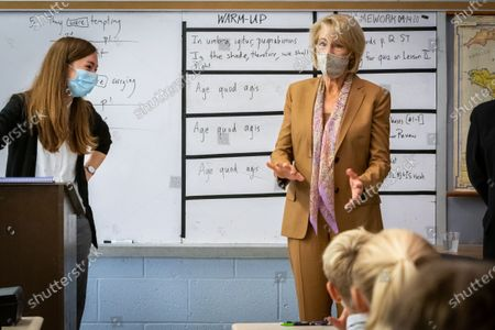 Latin teacher Tess DeRocher (l) listens as U.S. Secretary of Education Betsy DeVos (r) visits her classroom at Sacred Heart Academy, a Catholic K-12 school in Grand Rapids, Michigan on September 14, 2020 to witness how the school utilized protocols to safely reopen during the coronavirus pandemic.