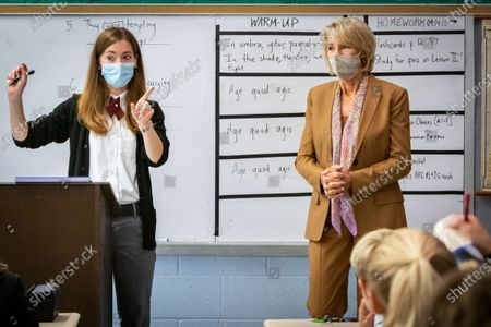 Latin teacher Tess DeRocher (l) asks students questions as U.S. Secretary of Education Betsy DeVos (r) visits her classroom at Sacred Heart Academy, a Catholic K-12 school in Grand Rapids, Michigan on September 14, 2020 to witness how the school utilized protocols to safely reopen during the coronavirus pandemic.