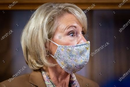 U.S. Secretary of Education Betsy DeVos speaks to the press as she visits Sacred Heart Academy, a Catholic K-12 school in Grand Rapids, Michigan on September 14, 2020 to witness how the school utilized protocols to safely reopen during the coronavirus pandemic.