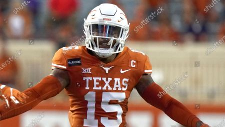 Texas' Chris Brown (15) reacts after a play =au during the first half of an NCAA college football game in Austin, Texas