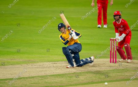 Stock Image of Yorkshire's George Hill hits out against Lancashire.