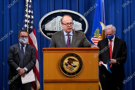 Stock Picture of Jeff Clark, Assistant Attorney General for the Environment and Natural Resources Division, speaks as Deputy Attorney General Jeffrey Rosen, right, and Environmental Protection Agency (EPA) Administrator Andrew Wheeler, left, look on during a news conference at the Justice Department in Washington, . Automakers Daimler AG and subsidiary Mercedes-Benz USA have agreed to pay $1.5 billion to the U.S. government and California state regulators to resolve emissions cheating allegations