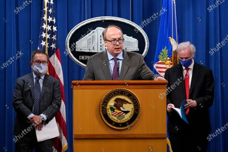 Stock Image of Jeff Clark, Assistant Attorney General for the Environment and Natural Resources Division, speaks as Deputy Attorney General Jeffrey Rosen, right, and Environmental Protection Agency (EPA) Administrator Andrew Wheeler, left, look on during a news conference at the Justice Department in Washington, DC, USA, 14 September 2020.  Automakers Daimler AG and subsidiary Mercedes-Benz USA have agreed to pay $1.5 billion to the US government and California state regulators to resolve emissions cheating allegations.