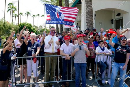 Supporters of President Donald Trump cheer on the arrival of Arizona Republican Party chairperson Kelli Ward as they wait in line prior to entering a Latinos for Trump Coalition roundtable event where the president is scheduled to speak, in Phoenix