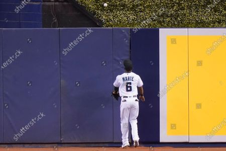Miami Marlins center fielder Starling Marte (6) watches a ball go over the wall for a solo home run hit by Philadelphia Phillies' Andrew McCutchen during the first inning of a baseball game, in Miami