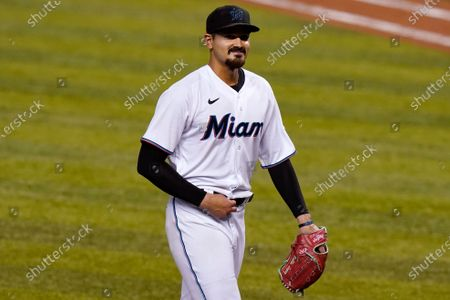 Miami Marlins starter Pablo Lopez smiles after pitching during the seventh inning of a baseball game against the Philadelphia Phillies, in Miami