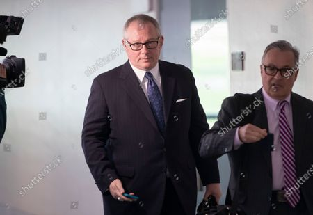 Former Donald Trump campaign official Michael Caputo, left, joined by his attorney Dennis C. Vacco, leaves after being interviewed by Senate Intelligence Committee staff investigating Russian meddling in the 2016 presidential election, on Capitol Hill in Washington. A House subcommittee examining President Donald Trump's response to the coronavirus pandemic is launching an investigation into reports that political appointees have meddled with routine government scientific data to better align with Trump's public statements. The Democrat-led subcommittee said Sept. 14, 2020 that it is requesting transcribed interviews with seven officials from the Centers for Disease Control and Prevention and the Department of Health and Human Services, including communications aide Michael Caputo