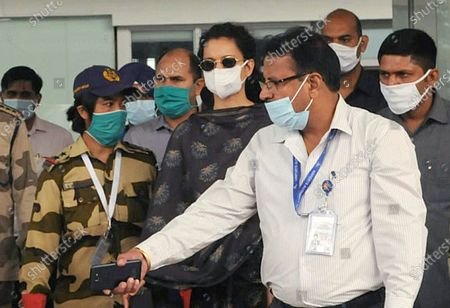 Bollywood actress Kangana Ranaut accompanied by security officials as she arrives at Chandigarh International Airport from Mumbai  on September 14, 2020 in Mohali, India.