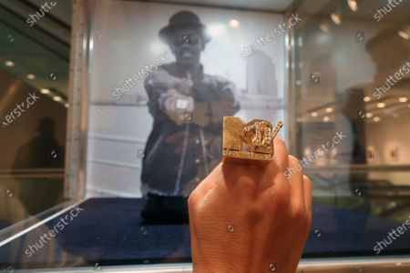 Woman holds Fab 5 Freddy's MTV ring at Sotheby's auction house in New York, . The ring, designed by the MTV host, is expected to sell for between $20,000 to $30,000 dollars at the first-ever dedicated hip-hop auction at a major international auction house on Tuesday, Sept. 15. Fred Brathwaite, better known as Fab 5 Freddy, provided the ring for auction