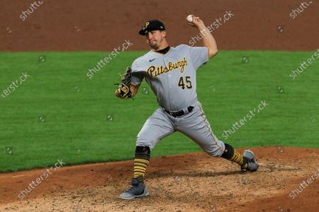 Stock Image of Pittsburgh Pirates' Derek Holland throws during a baseball game against the Cincinnati Reds in Cincinnati, . The Reds won 9-4
