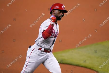 Philadelphia Phillies' Andrew McCutchen rounds the bases after hitting a solo home run during the first inning of a baseball game against the Miami Marlins, in Miami