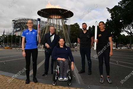(L-R) Tamsin Colley, AOC President John Coates, Paralympian Louise Savage, Olympian Ian Thorpe and Tenayah Logan pose for a photo infront of the Sydney 2000 Olympic Cauldron as it's lit to celebrate the 20th Anniversary of the Sydney 2000 Olympic Games Opening Ceremony at Cathy Freeman Park in Sydney, Australia, 15 September 2020.