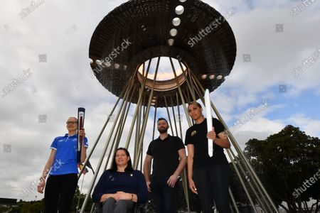 (L-R) Tamsin Colley, Paralympian Louise Savage, Olympian Ian Thorpe and Tenayah Logan pose for a photo infront of the Sydney 2000 Olympic Cauldron as it's lit to celebrate the 20th Anniversary of the Sydney 2000 Olympic Games Opening Ceremony at Cathy Freeman Park in Sydney, Australia, 15 September 2020.