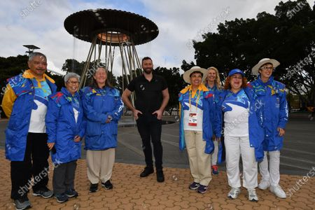 Olympian Ian Thorpe (C) chats with Olympic volunteers as the Sydney 2000 Olympic Cauldron is lit as part of the 20th Anniversary celebrations celebrating 20 years since the Opening Ceremony at Cathy Freeman Park in Sydney, Australia, 15 September 2020.