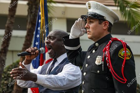 Stock Picture of Tim Kepler, left, flanked by OCFA honor guard Nick Valbuena, sings national anthem at a ceremony held at Richard Nixon Presidential Library and Museum to commemorate 19th anniversary of the 9/11 terrorist attacks on Friday, Sept. 11, 2020 in Yorba Linda , CA. (Irfan Khan / Los Angeles Times)