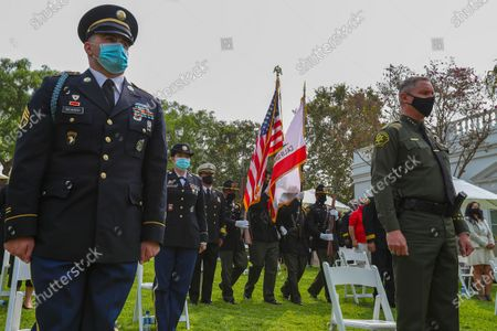 Orange County Sheriff Department color guard, center, present colors at a ceremony held at Richard Nixon Presidential Library and Museum to commemorate19th anniversary of the 9/11 terrorist attack on Friday, Sept. 11, 2020 in Yorba Linda , CA. (Irfan Khan / Los Angeles Times)