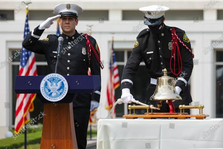 OCFA honor guard Nick Valbuena, left, salutes as his colleague Jeff Garbaczewski rings bell in Final Alarm at the end of a ceremony held at Richard Nixon Presidential Library and Museum to commemorate 19th anniversary of the 9/11 terrorist attacks on Friday, Sept. 11, 2020 in Yorba Linda , CA. (Irfan Khan / Los Angeles Times)