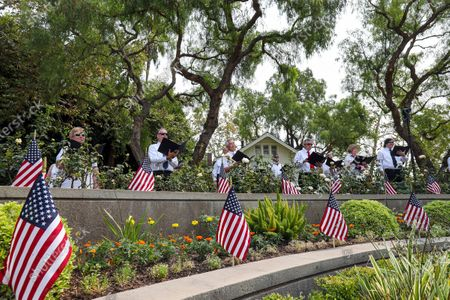 Stock Photo of Orange Community Master Chorale performs at a ceremony held at Richard Nixon Presidential Library and Museum to commemorate 19th anniversary of the 9/11 terrorist attacks on Friday, Sept. 11, 2020 in Yorba Linda , CA. (Irfan Khan / Los Angeles Times)