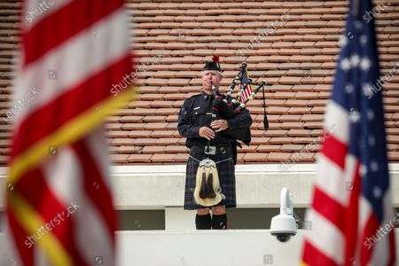 Stock Image of Orange County Fire Authority piper Kem Murray performs at a ceremony held at Richard Nixon Presidential Library and Museum to commemorate 19th anniversary of the 9/11 terrorist attacks on Friday, Sept. 11, 2020 in Yorba Linda , CA. (Irfan Khan / Los Angeles Times)