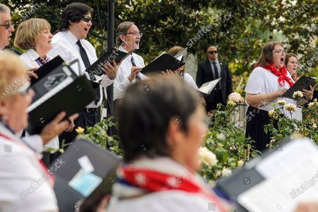 Orange Community Master Chorale performs at a ceremony held at Richard Nixon Presidential Library and Museum to commemorate 19th anniversary of the 9/11 terrorist attacks on Friday, Sept. 11, 2020 in Yorba Linda , CA. (Irfan Khan / Los Angeles Times)