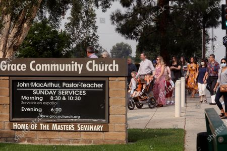 SUN VALLEY, CA - SEPTEMBER 13, 2020 - - Grace Community Church parishioners make their way to Sunday service in Sun Valley on September 13, 2020. The church held a packed morning service today, defying a court order directing them to refrain from holding indoor services due to the COVID-19 pandemic. L.A. County Superior Court Judge Mitchell Beckloff sided with public health officials, who took legal action last month to enforce health orders against Grace Community Church, an evangelical congregation in Sun Valley that has been holding Sunday worship services indoors since July 26. The majority of the parishioners refused to wear a mask.(Genaro Molina / Los Angeles Times)