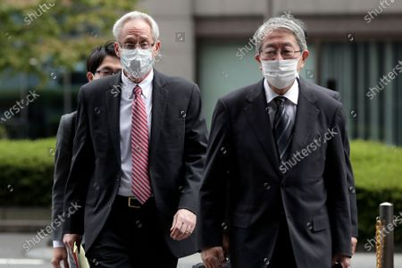 Greg Kelly (L), former representative director of Nissan Motor Co., arrives for the first trial hearing at the Tokyo District Court in Tokyo, Japan, 15 September 2020. Kelly is charged with aiding in the underreporting of future compensation for former Nissan CEO Carlos Ghosn.