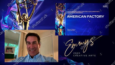 "Stock Image of Rob Riggle presents the award for Outstanding Directing For A Documentary/Nonfiction Program to Steven Bognar and Julia Reichert for ""American Factory"" during the first night of the 2020 Creative Arts Emmy Awards, streamed live on Emmys.com on"