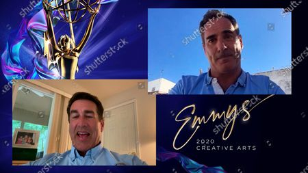 "Stock Photo of Rob Riggle presents the award for Outstanding Writing For A Nonfiction Program to Mark Lewis for ""Don't F**k With Cats: Hunting An Internet Killer"" during the first night of the 2020 Creative Arts Emmy Awards, streamed live on Emmys.com on"