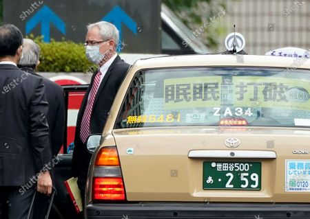 Greg Kelly (R), former representative director of Nissan Motor Co., arrives for the first trial hearing at the Tokyo District Court in Tokyo, Japan, 15 September 2020. Kelly is charged with aiding in the underreporting of future compensation for former Nissan Chairman Carlos Ghosn.