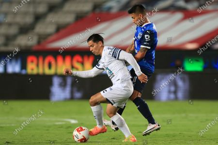 Victor Davila (L) of Pachuca in action against Maximiliano Meza (R) of Monterrey during the Liga MX 2020 Apertura Tournament soccer match between Pachuca and Monterrey at the Hidalgo Stadium in Pachuca, Mexico, 14 September 2020.
