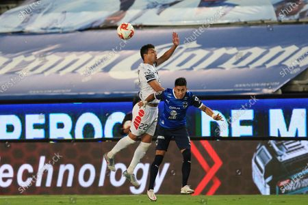 Gustavo Cabral (L) of Pachuca in action against Maximiliano Meza (R) of Monterrey during the Liga MX 2020 Apertura Tournament soccer match between Pachuca and Monterrey at the Hidalgo Stadium in Pachuca, Mexico, 14 September 2020.