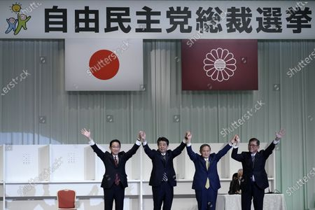 Japan's former Foreign Minister Fumio Kishida (1st L), Prime Minister Shinzo Abe (2nd L), Chief Cabinet Secretary Yoshihide Suga (2nd R) and former Defense Minister Shigeru Ishiba celebrate after Suga was elected as the new president of the ruling Liberal Democratic Party (LDP) in Tokyo, Japan, Sept. 14, 2020.