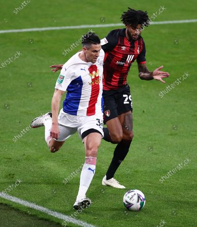 Martin Kelly of Crystal Palace and Philip Billing of Bournemouth.