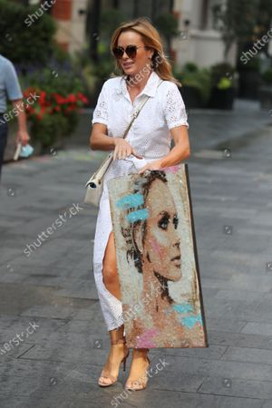Stock Image of Amanda Holden holding a picture of herself at Global House radio