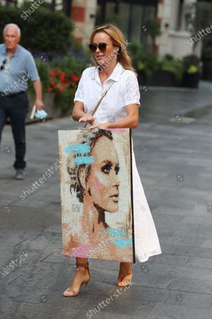Amanda Holden holding a picture of herself at Global House radio