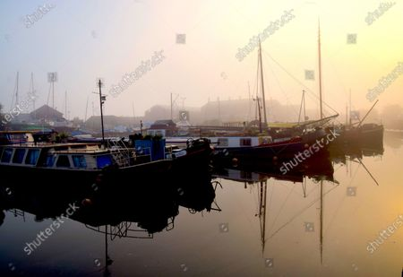 Fog banks have rolled in along the River Thames. Fog horns sounding from passing ships gave an eerie atmosphere to the estuary town of Gravesend.
