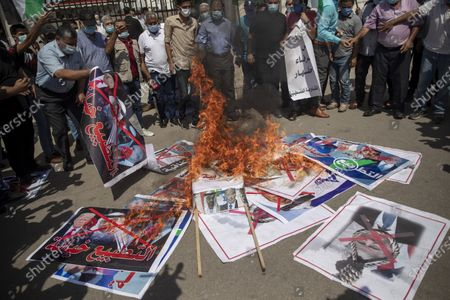 Palestinians burn pictures of U.S. president Donald Trump, Israeli Prime Minister Benjamin Netanyahu, Bahrain's King Hamad bin Isa Al Khalifa and and Abu Dhabi Crown Prince Mohammed bin Zayed al-Nahyan, during a protest against the United Arab Emirates and Bahraini normalization agreement with Israel, in Gaza City